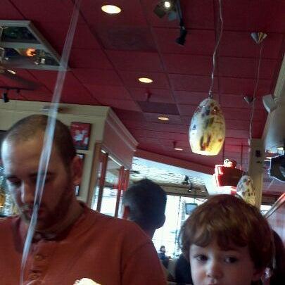 Photo taken at Red Robin Gourmet Burgers by Elisa C. on 2/25/2012