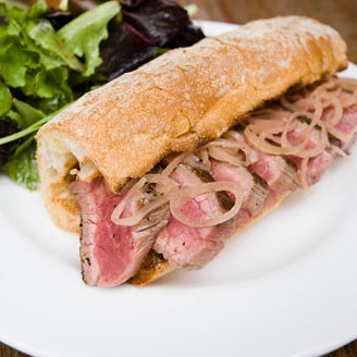 Spring for the juicy grilled flank-steak sandwich. The beef spends 24 hours in a flavor-boosting bath of oil, garlic, crushed peppercorns & pimentón. It's one of our #100best dishes & drinks of 2011.