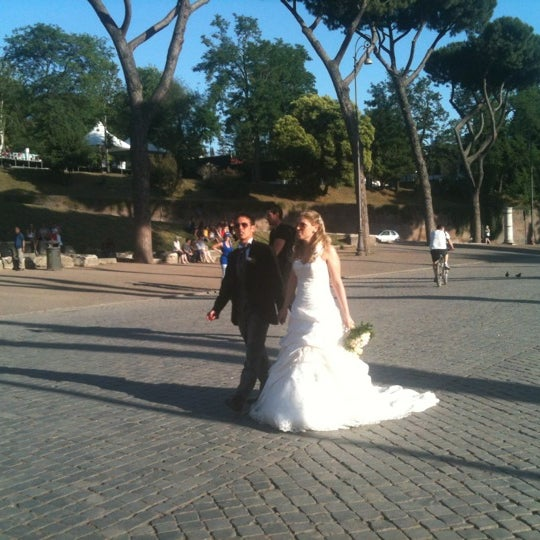 Photo taken at Piazza del Colosseo by Monica A. on 6/17/2012