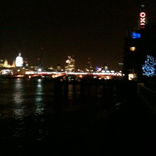 Photo taken at OXO Tower Brasserie by Henry B. on 2/14/2012