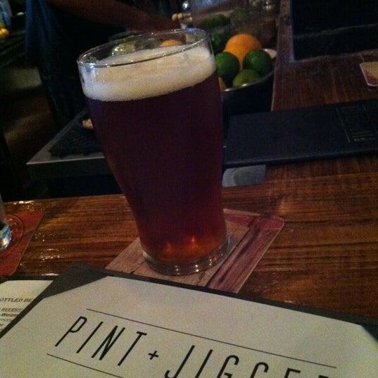 Photo taken at Pint + Jigger by Nathan K. on 7/16/2012