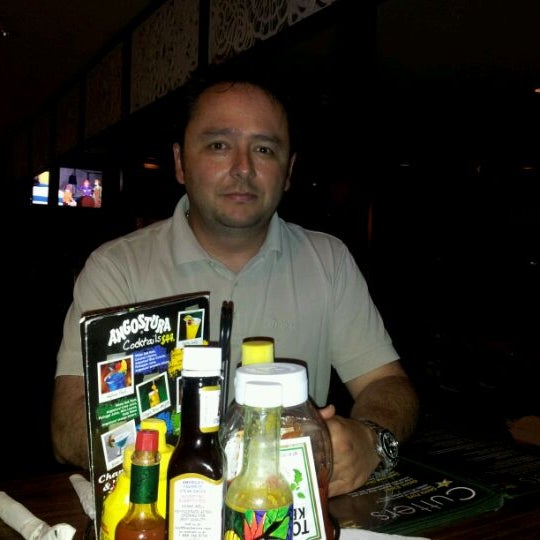 Photo taken at Woodford Café by Oskrfabio .. on 4/21/2012