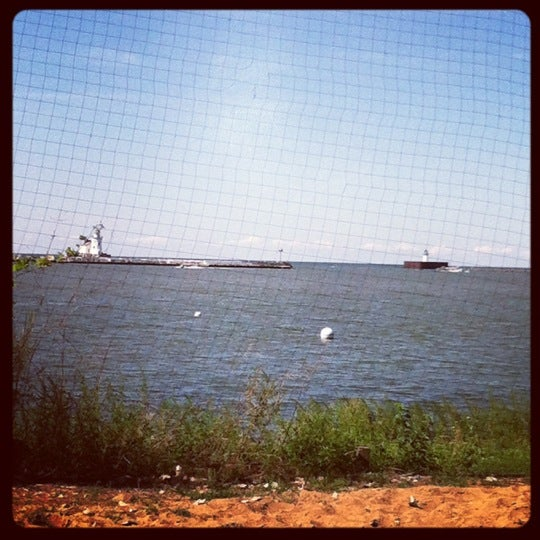 Photo taken at Whiskey Island Volleyball Courts by Emma B. on 8/18/2012