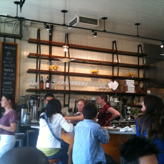 Photo taken at Universal Cafe by Alec H. on 9/4/2011