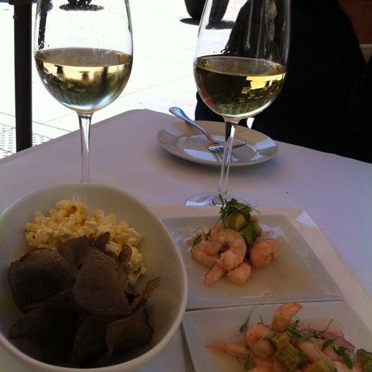 Photo taken at Village California Bistro & Wine Bar by Thaddeus C. on 9/2/2011
