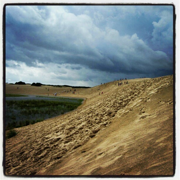 Photo taken at Jockey's Ridge State Park by Eric W. on 8/10/2012