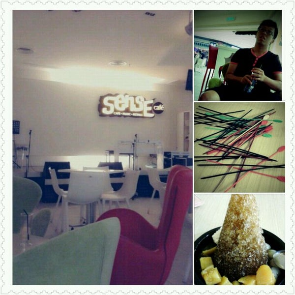 Photo taken at Sense Cafe by mel c. on 4/30/2012