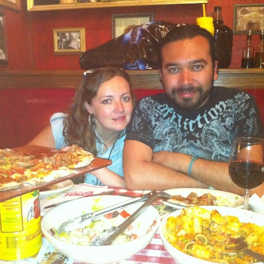 Photo taken at Buca di Beppo Italian Restaurant by José L. on 4/18/2012
