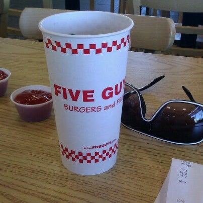 Photo taken at Five Guys by Carlos M. on 8/12/2012