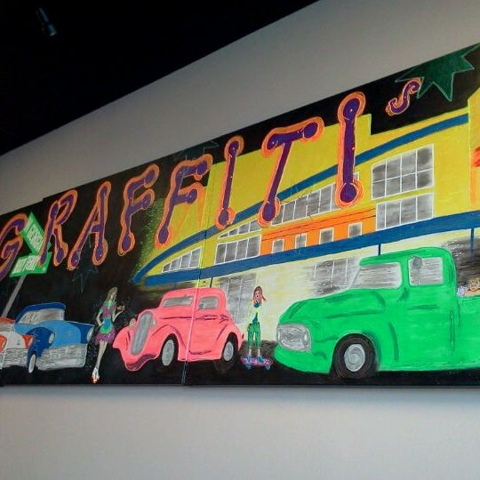 Photo taken at Graffiti's Burgers by Jenn on 2/4/2012