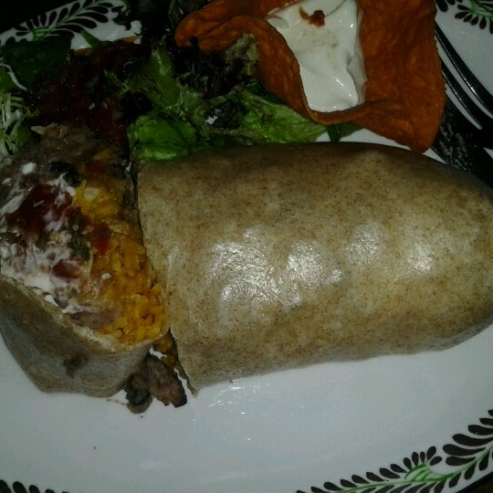 Photo taken at Burrito Bar & Kitchen by Whitney N. on 6/20/2012