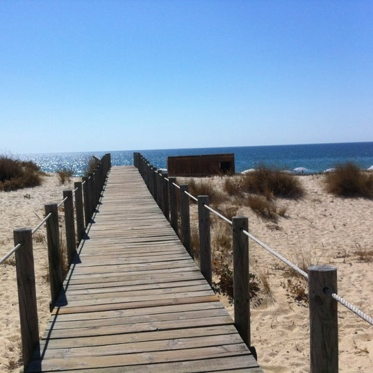 Photo taken at Praia do Barril by Sara A. on 9/12/2012