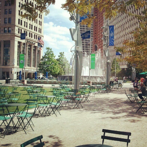 Photo taken at Campus Martius Park by Cristin M. on 8/5/2012