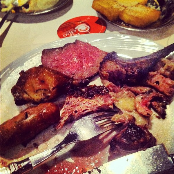 Photo taken at Fogo de Chão Churrascaria by Chelsea G. on 4/1/2012