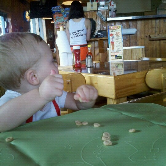 Photo taken at Hooters by Branden K. on 7/18/2012