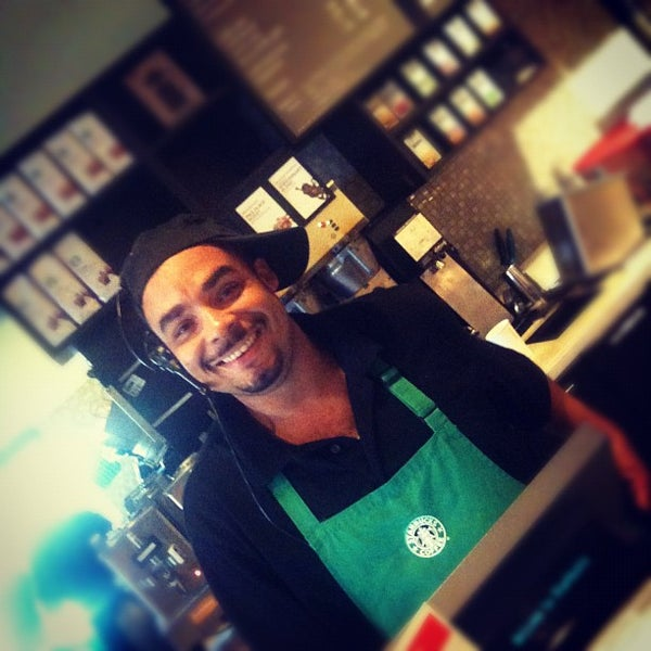 Photo taken at Starbucks by carlos v. on 9/12/2012