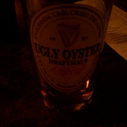 Photo taken at Ugly Oyster Drafthaus by Chuck K. on 10/11/2011