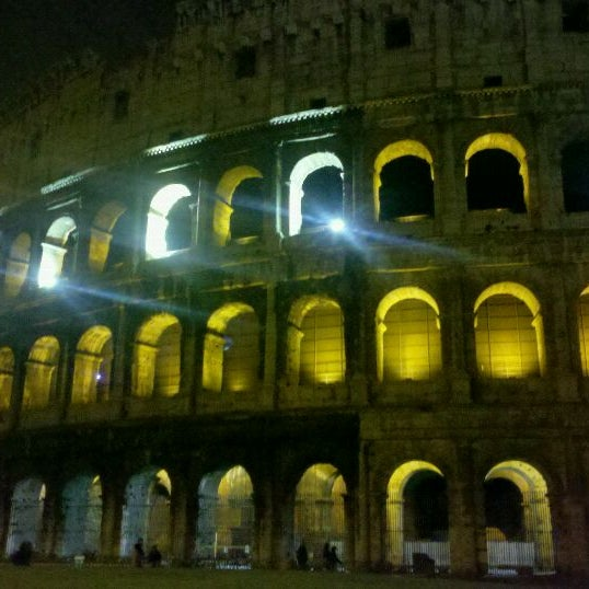 Photo taken at Piazza del Colosseo by Maria L. on 4/18/2012