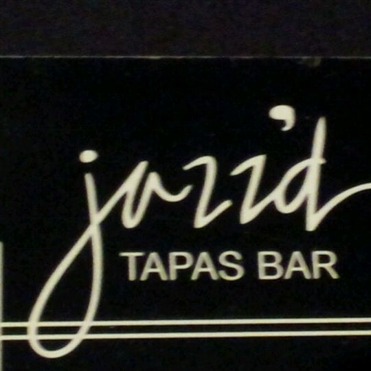Photo taken at Jazz'd Tapas Bar by Jackie C. on 3/23/2012
