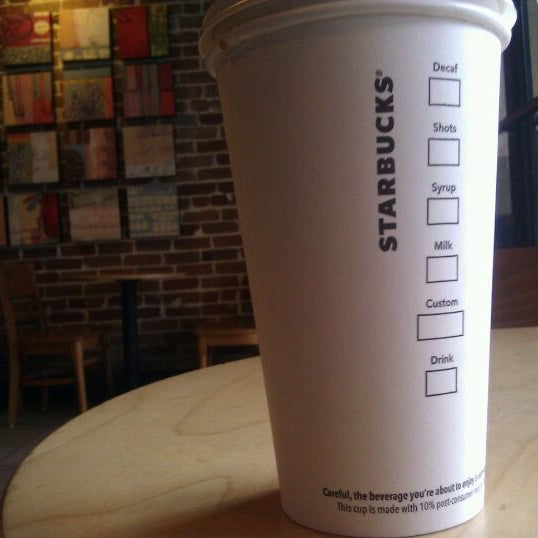 Photo taken at Starbucks by a Guy on Clematis on 1/11/2012