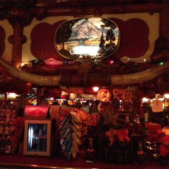 Photo taken at Million Dollar Cowboy Bar by Elizabeth R. on 5/7/2012