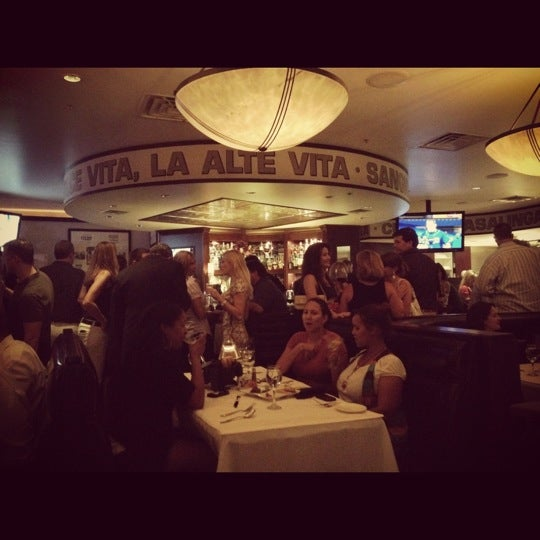 Photo taken at Timpano Italian Chop House by Lindsey B. on 5/16/2012