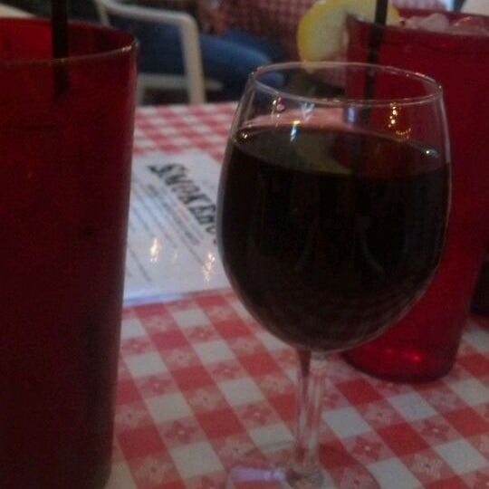 Photo taken at Cave Creek Smokehouse & Pour House Patio by Rose B. on 4/25/2012