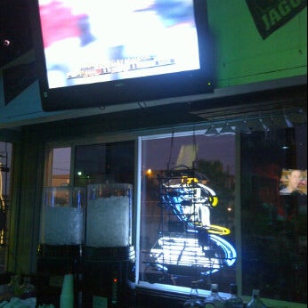Photo taken at The Surf Restaurant & Bar by Michael S. on 10/15/2011