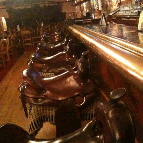 Photo taken at Million Dollar Cowboy Bar by Jenny V. on 3/28/2012