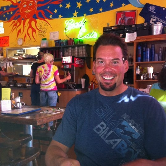 Photo taken at Squeeze In by Kathleen E. on 7/26/2011