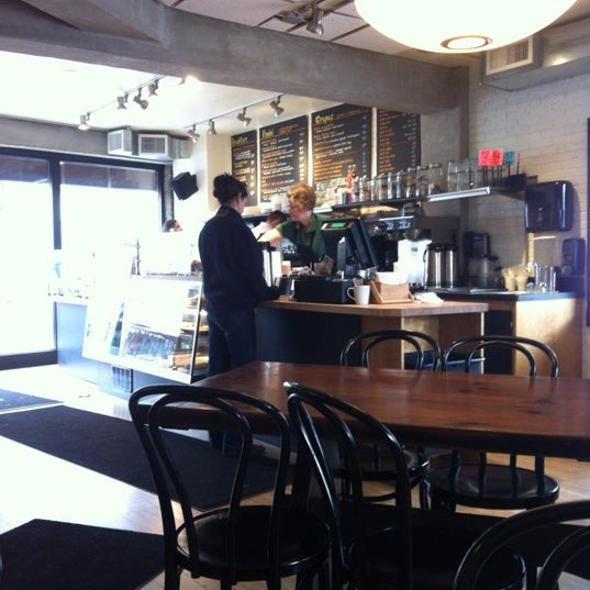 Photo taken at Luna Bakery Café by Adam P. on 3/6/2012