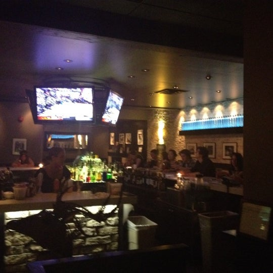 Photo taken at Earls Restaurant by Kristi on 6/22/2012