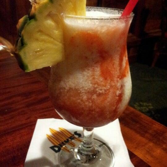 Photo taken at Duke's Waikiki by Teresa O. on 7/26/2012
