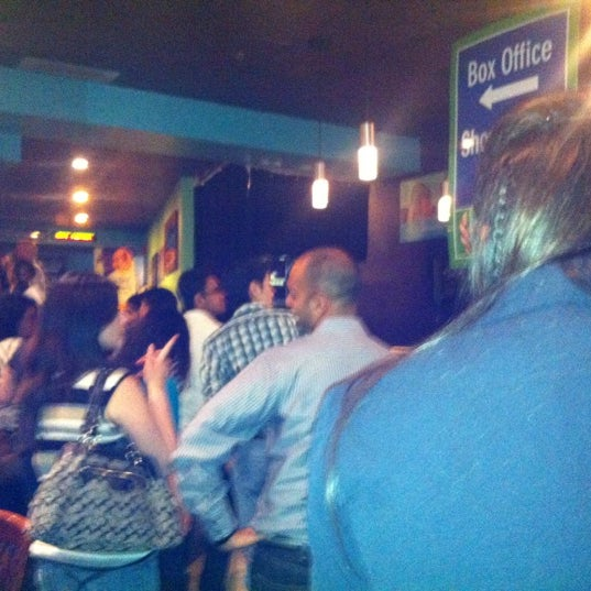 Photo taken at Absolute Comedy by Cassie D. on 7/28/2012