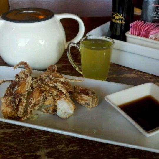 Photo taken at iSushi Cafe by Jenny B. on 8/7/2012