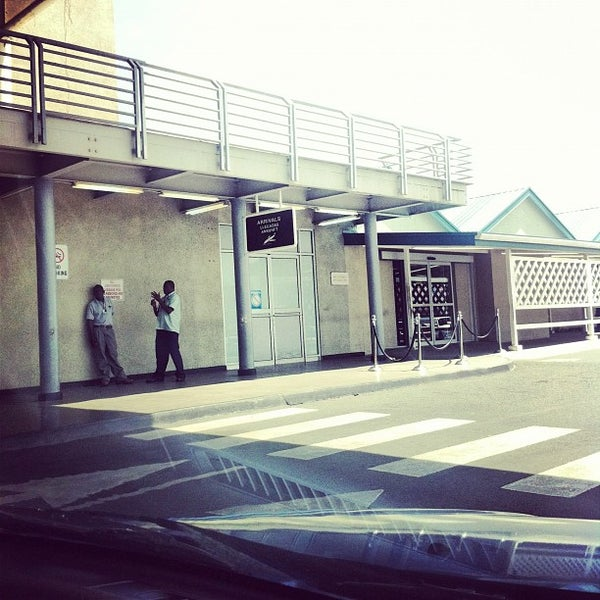Photo taken at A.N.R. Robinson International Airport (TAB) by Leeandro N. on 7/3/2012