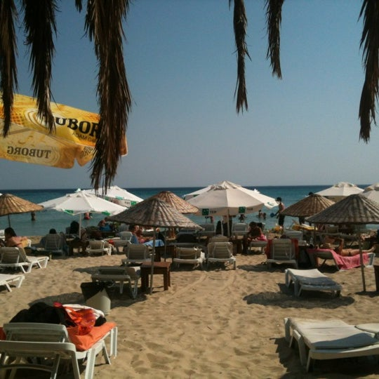 Photo taken at Ramo Beach by Servet K. on 7/20/2012