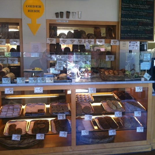 Photo taken at Model Bakery by Laurey T. on 7/13/2012
