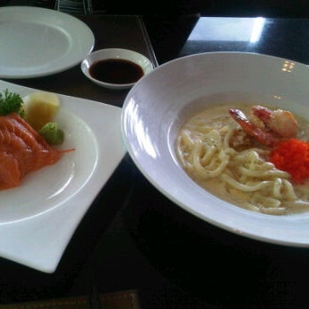 Photo taken at YASASHII Japanese Fusion Cuisine by aOm on 5/5/2012