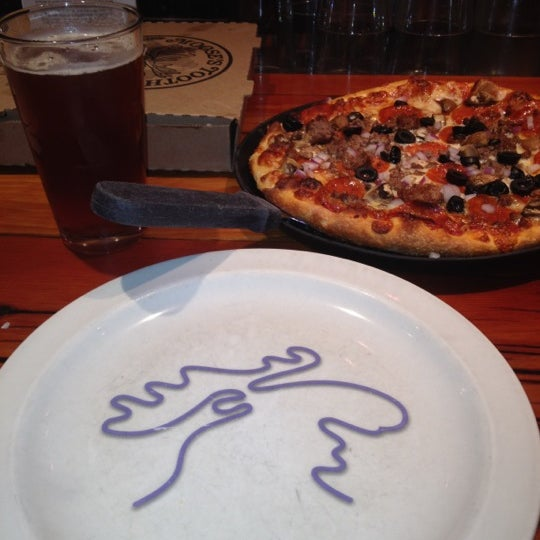 Photo taken at Moose's Tooth Pub & Pizzeria by Joe M. on 8/31/2012