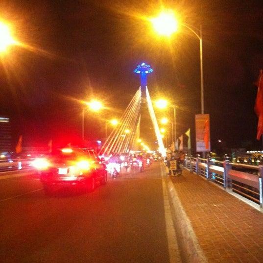 Photo taken at Cầu Sông Hàn (Han River Bridge) by Ryan F. on 7/8/2012