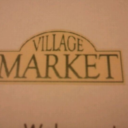 Photo taken at Village Market (Lobby Level) by Arnaldo R. on 4/5/2012