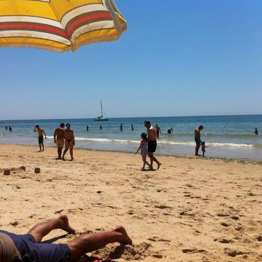 Photo taken at Praia do Barril by Nuno H. on 7/4/2012