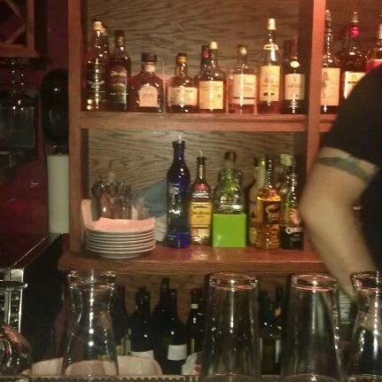 Photo taken at Joe Squared Pizza & Bar by Regina M. on 4/21/2012