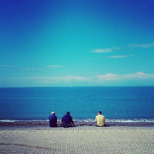 Photo taken at Aberystwyth Beach by David A. on 8/5/2012