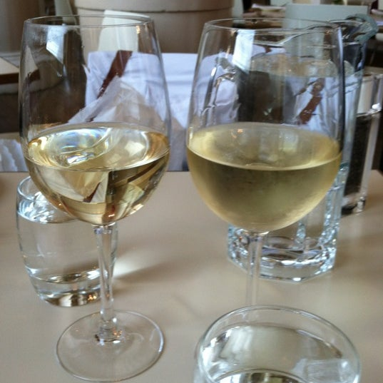 Photo taken at Victor and Carina Contini Ristorante by Catie C. on 5/21/2012