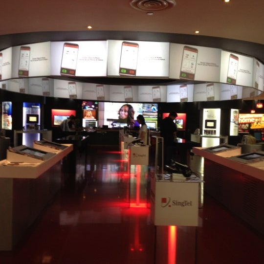 Photo taken at Singtel Shop by Abbie R. on 5/23/2012