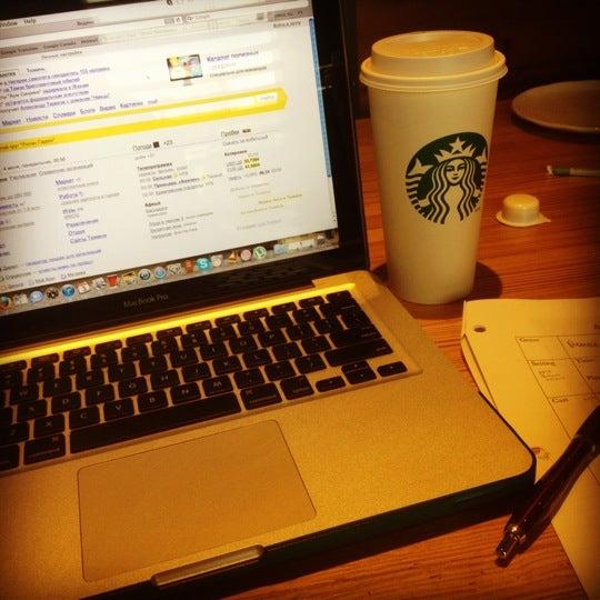 Photo taken at Starbucks by Yuliya on 6/23/2012