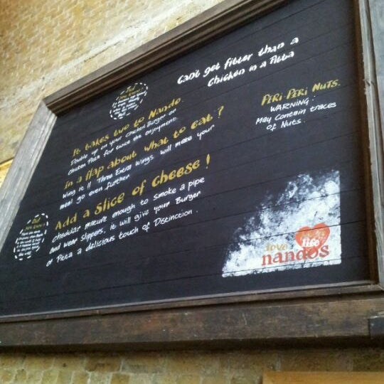Photo taken at Nando's by chris m. on 7/7/2012