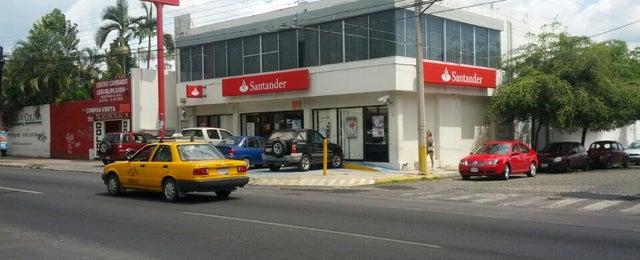 Photo taken at Santander by Jonathan L. on 6/11/2014